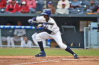 Asheville Tourists right fielder Raimel Tapia #15 squares to bunt during a game against the Greenville Drive at McCormick Field on May 18, 2014 in Asheville, North Carolina. The Tourists defeated the Drive 3-1. (Tony Farlow/Four Seam Images)
