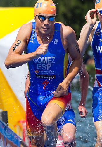 24 JUN 2012 - KITZBUEHEL, AUT - Javier Gomez (ESP) of Spain leaves the water at the end of the first swim lap during the elite men's 2012 World Triathlon Series round in Schwarzsee, Kitzbuehel, Austria (PHOTO (C) 2012 NIGEL FARROW)