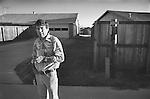 Dallas, Texas neighborhood alley way with man smoking cigarette. 1975