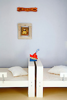 Jewelry designer Katerina Psoma decorated her island home on Kea, close to Athens, in a style that reflects her personality.  The house is simply decorated and accented with eccentric touches throughout.