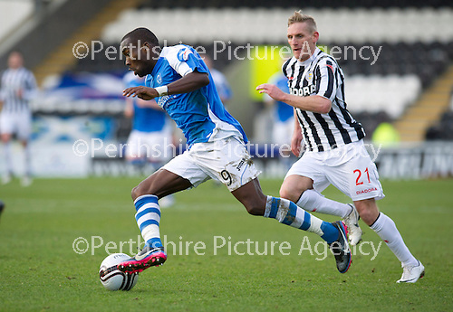 St Mirren v St Johnstone.....02.02.13      Scottish Cup.Gregory Tade gets round Gary Teale.Picture by Graeme Hart..Copyright Perthshire Picture Agency.Tel: 01738 623350  Mobile: 07990 594431