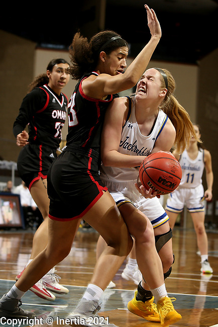SIOUX FALLS, SD - MARCH 6: Tori Nelson #20 of the South Dakota State Jackrabbits shoots tries to get the ball to the basket against Mariah Murdie #33 of the Omaha Mavericks during the Summit League Basketball Tournament at the Sanford Pentagon in Sioux Falls, SD. (Photo by Dave Eggen/Inertia)