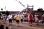 The Fourth of July Parade in Cayucos Beach, California turns the tiny town into the biggest city on the Central Coast for one day every year.  Surfers marching.