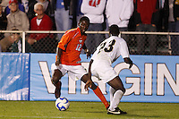 Virginia Tech Hokies forward Patrick Nyarko (12) and Wake Forest Demon Deacons defender Ike Opara (23) during an NCAA College Cup semi-final match at SAS Stadium in Cary, NC on December 14, 2007. Wake Forest defeated Virginia Tech 2-0.