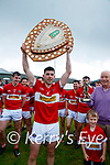 Dingle Captain Mikey Geaney with the League shield celebrates with the Dingle team after winning the Division Football League final over Kerins O'Rahilly's at Annascaul on Sunday.
