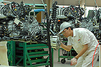 A worker on the engine production line of the Honda Accord at the new Guangzhou Honda Automobile Co. Ltd.. factory. The plant built at a cost of 140 million US$ is one of the most advanced car plants in the world. It has a state of the art production line as well as the world's first total water re-cycling sytem..