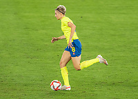YOKOHAMA, JAPAN - AUGUST 6: Lina Hurtig #8 of Sweden dribbles during a game between Canada and Sweden at International Stadium Yokohama on August 6, 2021 in Yokohama, Japan.
