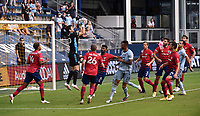 KANSAS CITY, KS - SEPTEMBER 19: Jimmy Maurer #20 of FC Dallas brings down a cross during a game between FC Dallas and Sporting Kansas City at Children's Mercy Park on September 19, 2020 in Kansas City, Kansas.
