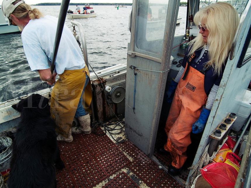 Bo Christenson and Donna J. Cote, Quahoggers at work on Narragaanseet bay near Warwick, Rhode Island
