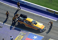 Apr. 28, 2012; Baytown, TX, USA: Aerial view of NHRA crew members for funny car driver Jeff Arend during qualifying for the Spring Nationals at Royal Purple Raceway. Mandatory Credit: Mark J. Rebilas-