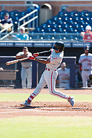 Scottsdale Scorpions third baseman Arquimedes Gamboa (7), of the Philadelphia Phillies organization, swings at a pitch during an Arizona Fall League game against the Peoria Javelinas at Peoria Sports Complex on October 18, 2018 in Peoria, Arizona. Scottsdale defeated Peoria 8-0. (Zachary Lucy/Four Seam Images)