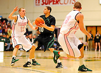 13 February 2011: Binghamton University Bearcat guard Jimmy Gray, a Sophomore from  Binghamton, NY, in action against the University of Vermont Catamounts at Patrick Gymnasium in Burlington, Vermont. The Catamounts came from behind to defeat the Bearcats 60-51 in their America East matchup. The Cats took part in the National Pink Zone Breast Cancer Awareness Program by wearing special white jerseys with pink trim. The jerseys were auctioned off following the game with proceeds going to the Vermont Cancer Center. Mandatory Credit: Ed Wolfstein Photo