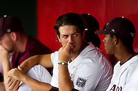 Brock Chaffin (25) of the Missouri State Bears sits in the dugout with teammates during a game against the Evansville Purple Aces at Hammons Field on May 12, 2012 in Springfield, Missouri. (David Welker/Four Seam Images)