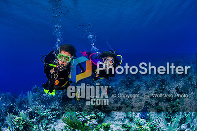 8 June 2015: Divers Josh Wolfstein (left) and Sally Herschorn (right) explore the reef at Ocean Point Reef, on the North Shore of Grand Cayman Island. Located in the British West Indies in the Caribbean, the Cayman Islands are renowned for excellent scuba diving, snorkeling, beaches and banking.  Mandatory Credit: Ed Wolfstein Photo *** RAW (NEF) Image File Available ***