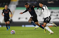 13th March 2021, Craven Cottage, London, England;  Manchester Citys Gabriel Jesus is challenged by Fulhams Kenny Tete during the English Premier League match between Fulham and Manchester City at Craven Cottage in London