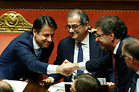 The Italian Premier Giuseppe Conte, Minister of Economy Giovanni Tria and undersecretary at the Residence Giancarlo Giorgetti<br /> Rome December 19th 2018. Senate. Speech of the Italian Premier about the results of the negotiation with the European Union about the  budget plan.<br /> Foto Samantha Zucchi Insidefoto