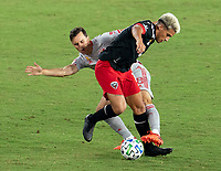 WASHINGTON, DC - SEPTEMBER 12: Yamil Asad #11 of D.C. United fights for the ball with Jared Stroud #8 of the New York Red Bulls during a game between New York Red Bulls and D.C. United at Audi Field on September 12, 2020 in Washington, DC.