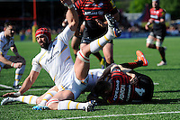Jonathan Thomas of Worcester Warriors flies in to halt Chris Ashton of Saracens just short of the tryline during the Aviva Premiership match between Saracens and Worcester Warriors at Allianz Park on Saturday 3rd May 2014 (Photo by Rob Munro)