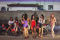 Transgender prostitutes and female prostitutes are seen in Angeles City, Republic of the Philippines, 08 November 2014. The 'sin city', which sprung up on the fringes of a US Air Force base during the Vietnam war, has a reputation for cheap sex, and was a favourite destination for alleged murderer Rurik Jutting, who used to fly to Angeles City from Hong Kong for debauched weekends. The British banker is currently on remand at a secure facility in Hong Kong for allegedly murdering two Indonesian prostitutes in his flat whilst high on alcohol and cocaine.