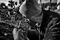 An ethnic Shan man smokes heroin in the Chinese border town Ruili. Blamed for perpetuating the country's civilian conflict the illicit drug market provides vital revenue for the Tatmadaw and armed groups in northern Myanmar.