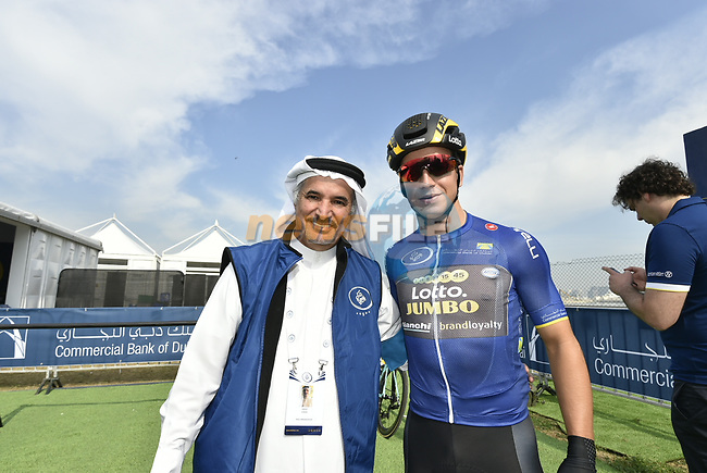 H.E. Saeed Hareb and race leader Dylan Groenewegen (Ned) Team Lotto NL-Jumbo at sign on before the start of Stage 2 The  Ras Al Khaimah Stage of the Dubai Tour 2018 the Dubai Tour's 5th edition, running 190km from Skydive Dubai to Ras Al Khaimah, Dubai, United Arab Emirates. 7th February 2018.<br /> Picture: LaPresse/Fabio Ferrari | Cyclefile<br /> <br /> <br /> All photos usage must carry mandatory copyright credit (© Cyclefile | LaPresse/Fabio Ferrari)