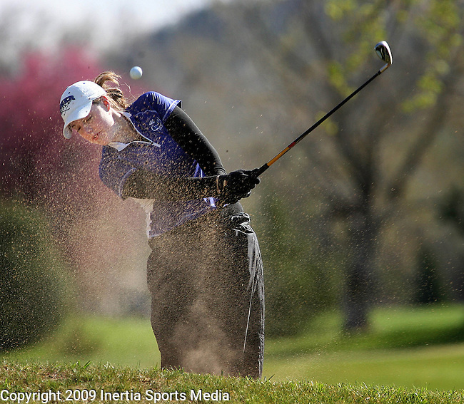 RAPID CITY, SD - MAY 13, 2009 :  Carly Hayes of Dakota Wesleyan hits from the sand onto the second green at Meadowbrook Golf Course in Rapid City Wednesday during the 2009 NAIA Women's Golf National Championships. (Photo by Dick Carlson/Inertia)
