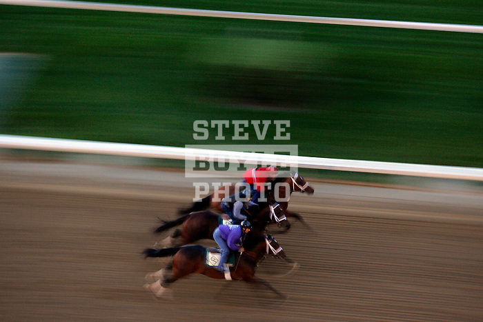 Three horses and jockeys practice on the track at Churchill Downs during a morning workout in Louisville, Kentucky on May 6, 2006.  Barbaro, ridden by Edgar Prado, won the 132nd Kentucky Derby in the tenth race of the day......