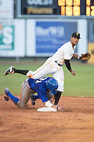Austin Bailey (7) of the Burlington Royals follows through on a throw to first base as Brandon Dulin (31) of the Burlington Royals slides into second base at Boyce Cox Field on July 10, 2015 in Bristol, Virginia.  The Pirates defeated the Royals 9-4. (Brian Westerholt/Four Seam Images)