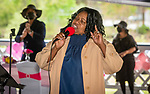 WATERBURY, CT 050821JS06—Vickie Howard-Steward sings a song during a Mother's Day celebration held Saturday at Lakewood Park in Waterbury. The event was hosted by the Black Women United Committee. <br /> Jim Shannon Republican American