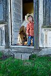 Little cowpoke with miniature horse, San Luis Obispo, California