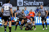 Tendai Mtawarira of Sharks is tackled by Justin Melck of Saracens during the Sanlam Private Investments Shield match between Saracens and the Cell C Sharks at Allianz Park on Saturday 25th January 2014 (Photo by Rob Munro)