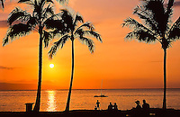 Beachgoers enjoy the sunset, seen from Old Airport Beach, north of Ka'anapali beach, Maui.