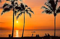 Beachgoers enjoy the sunset, seen from Old Airport Beach, north of Ka'anapali beach, Maui.
