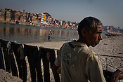 A washerman dries the clothes on the banks of river Ganges in the ancient city of Varanasi in Uttar Pradesh, India. Photograph: Sanjit Das/Panos