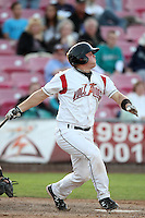 Salem-Keizer catcher Daniel Burkhart #15 bats against the Eugene Emeralds at Volcanoes Stadium on August 9, 2011 in Salem-Keizer,Oregon. Eugene defeated Salem-Keizer 13-7.(Larry Goren/Four Seam Images)