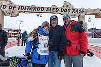 After finishing the race, Cindy Gallea poses at the finish line with her father Jim and her son Jim in Nome on Sunday  March 22, 2015 during Iditarod 2015.  <br /> <br /> (C) Jeff Schultz/SchultzPhoto.com - ALL RIGHTS RESERVED<br />  DUPLICATION  PROHIBITED  WITHOUT  PERMISSION
