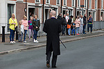 """© Joel Goodman - 07973 332324 . 28/08/2015 . Salford , UK . The procession passes along Fitzwarren Street , watched by people lining the pavements . The funeral of Paul Massey at St Paul's CE Church in Salford . Massey , known as Salford's """" Mr Big """" , was shot dead at his home in Salford last month . Photo credit : Joel Goodman"""