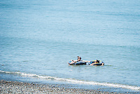 Aberystwyth, Ceredigion, West Wales, UK Monday 29th August 2016. UK Weather: People coming out and taking advantage of the fine Bank Holiday weather temperatures are expected to hit 19 degrees with clear skies. Two teenage girls soak up the sun whilst floating in two inflatatble rings.