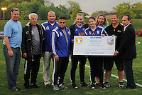 Piscataway, NJ, May 13, 2016. Half time check presentation by Sky Blue FC general manager Tony Novo and representatives of U.S. Parma to Kids Walk for Kids with Cancer. Sky Blue FC defeated the Boston Breakers, 1-0, in a National Women's Soccer League (NWSL) match at Yurcak Field.