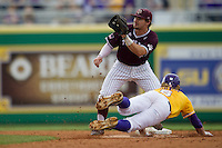 Texas A&M Aggies second baseman Ryne Birk (2) waits for a throw as LSU outfielder Andrew Stevenson (6) slides into second base during the Southeastern Conference baseball game on April 25, 2015 at Alex Box Stadium in Baton Rouge, Louisiana. Texas A&M defeated LSU 6-2. (Andrew Woolley/Four Seam Images)