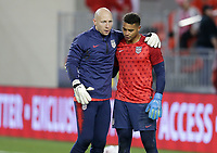 TORONTO, ON - OCTOBER 15: Brad Guzan and teammate  Zack Steffen #1 of the United States exchange a few words during a game between Canada and USMNT at BMO Field on October 15, 2019 in Toronto, Canada.