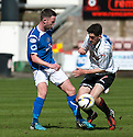 Stranraer's Grant Gallagher and Pars' Shaun Byrne challenge for the ball.