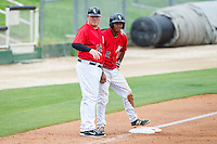 Kannapolis Intimidators manager Pete Rose Jr. (14) goes over the situation with Cleuluis Rondon (5) at third base during the game against the West Virginia Power at CMC-Northeast Stadium on April 30, 2014 in Kannapolis, North Carolina.  The Intimidators defeated the Power 2-1 in game one of a double-header.  (Brian Westerholt/Four Seam Images)