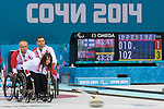 Sochi, RUSSIA - Mar 10 2014 -  Ina Forrest makes a shot with Dennis Thiessen and Mark Ideson behind her during Canada vs USA in Wheelchair Curling round robin play at the 2014 Paralympic Winter Games in Sochi, Russia.  (Photo: Matthew Murnaghan/Canadian Paralympic Committee)