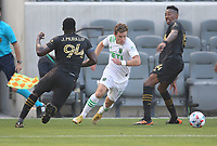 LOS ANGELES, CA - APRIL 17: Jon Gallagher #17 of Austin FC turns with the ball during a game between Austin FC and Los Angeles FC at Banc of California Stadium on April 17, 2021 in Los Angeles, California.