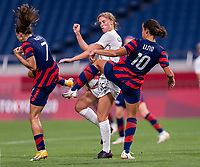 SAITAMA, JAPAN - JULY 24: Tobin Heath #7 and Carli Lloyd #10 of the USWNT fights for the ball with Daisy Cleverley #15 of New Zealand during a game between New Zealand and USWNT at Saitama Stadium on July 24, 2021 in Saitama, Japan.
