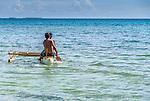 Men paddling a traditional canoe in Funafuti, Tuvalu