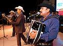"""voz-FoodCityFiestas0919 091407 Members from the group """"Los Originales Cadetes de Linares"""" (cq) performed at the Food City Fiestas Patrias in Phoenix, on Friday, Sept. 14, 2007.  Photo by AJ Alexander/La Voz"""