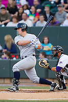 Zane Evans (39) of the Wilmington Blue Rocks follows through on his swing against the Winston-Salem Dash at BB&T Ballpark on April 3, 2014 in Winston-Salem, North Carolina.  The Blue Rocks defeated the Dash 3-1.  (Brian Westerholt/Four Seam Images)