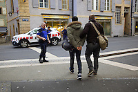 """Switzerland. The Republic and Canton of Neuchâtel. Neuchâtel. Downtown. Narcotics squad. """"Narko"""" operationn. A group of police officers on duty (with blue uniforms or in plain-clothes) arrest a drug dealer from Western Africa. The convict black man is handcuffed because he was caught selling illegal drugs (cocaine) in the streets. Plainclothes law enforcement is a method used by police. The policemen wear plainclothes or """"ordinary clothes"""" instead of a uniform in order to avoid detection or identification as law enforcement agents. Police officers in plainclothes must identify themselves when using their police powers. 1.04.15 © 2015 Didier Ruef"""